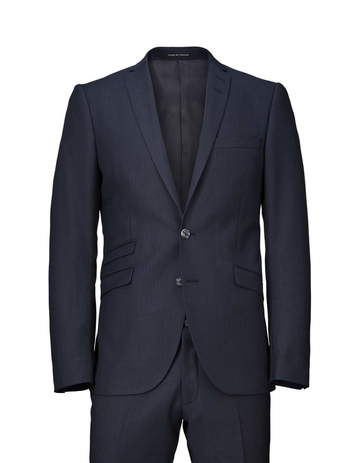 Nedvin wool suit-Men's slim fit suit in wool. High crochet, slimmed lapels and flap pockets. Two-button front closure. Comes with Herris trousers featuring low rise, narrow leg and slim fit for modern, clean profile.