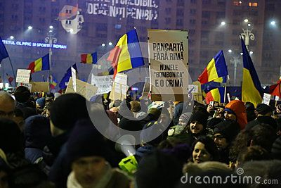 Protest against corruption and romanian government in Bucharest, Romania - placards with ironic lyrics for governors.