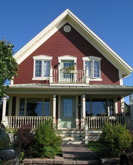 Colourful rural homes - You can't go wrong with red siding and small window panes.