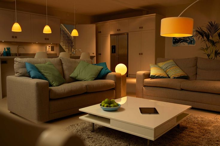 change the hue of the lights in the room by using a cursor hovering over a portion of a picture of the room.