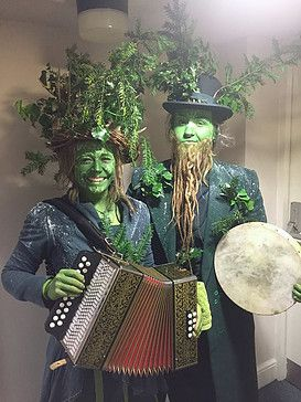 The Greens are a visually stunning musical statue/walkabout theatre act inspired by the Green Man combining Folk music, elaborate make-up, interactive performance and lots of energy. #greenman #nature #makeup #performance #trees #facepaint #thisandthatperformance #streetarts #costume #dreadlocks #dreadbeard #folkmusic #melodeon #theatre #festivals #events #birthdays #weddings #workshops #circus