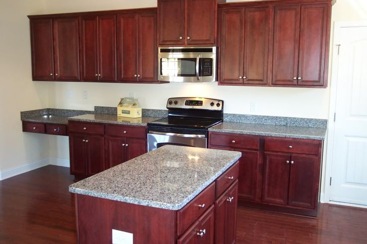 Caledonia Granite Countertops with Cherry Cabinets http://www ...