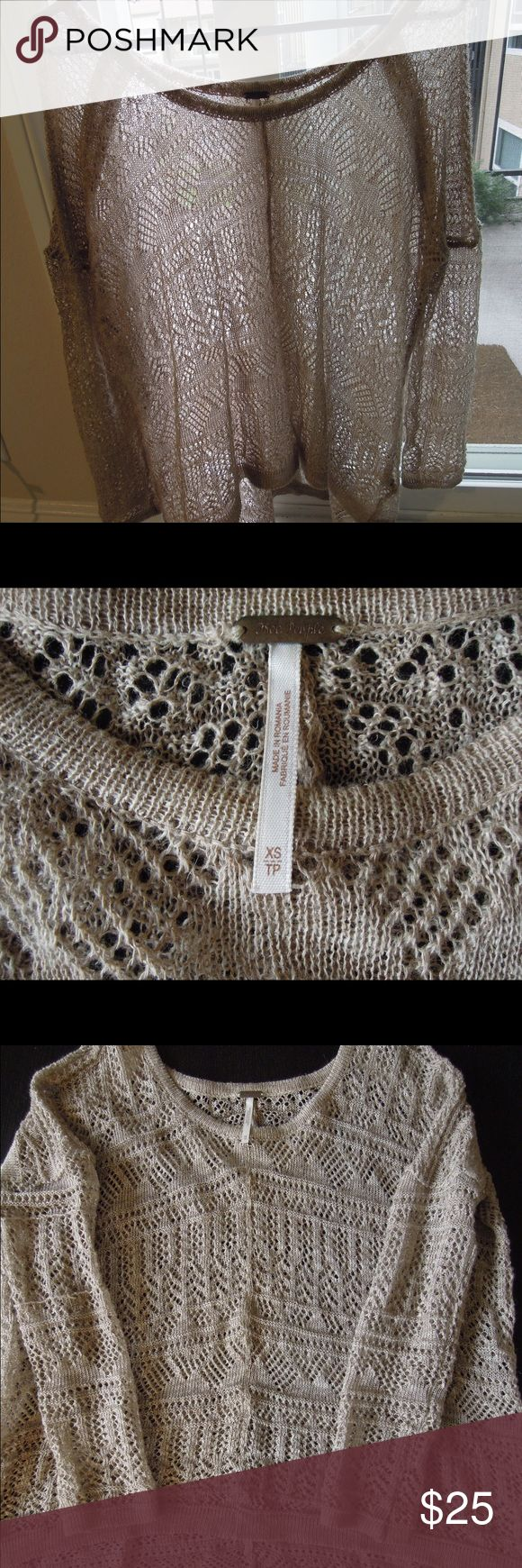 Free People lightweight layer This dark beige knit sweater is best for layering over a nude cami. It is very delicate and fits very loosely, and can be hand washed or dry cleaned. Free People Tops Tunics