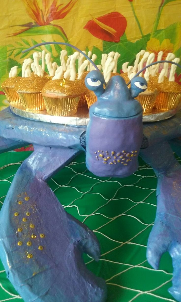 """Tomatoa cupcake stand for Moana party and """"shiny"""" cupcakes"""