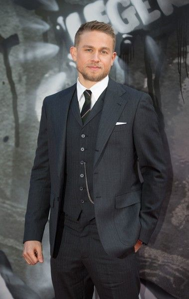 """Charlie Hunnam Photos Photos - British actor Charlie Hunnam poses for a photograph upon arrival at the European Premiere of """"King Arthur: Legend of the Sword"""" in London on May 10, 2017. / AFP PHOTO / Daniel LEAL-OLIVAS - The London Premiere of 'King Arthur: Legend of the Sword'"""