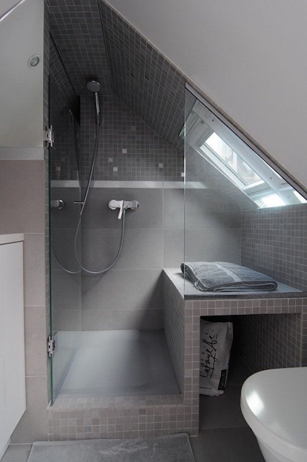 Beautiful gray tiled shower in a small attic
