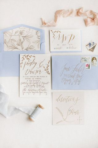 Powder blue and gold calligraphy wedding invitations | Ivy & Stone Photography | see more on: http://burnettsboards.com/2015/11/world-european-romance-themed-wedding/