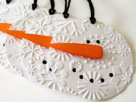 """snowman from an old CD? textured snowflake paper, felt nose and marker coal for eyes and mouth. This is a new twist on the old """"Paint a snowman out of a CD"""" thing. LOVE LOVE LOVE the textured paper idea! It looks so classy!"""