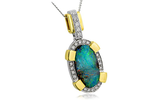 NATURAL BEAUTY  A fabulous free form 4.36 ct solid opal bead set with round cut diamonds. Set in 18ct yellow and white gold you can't go wrong with this pendant!  #opal #opalpendant #australianopal #opals #opaljewelry #opaljewellery #diamond
