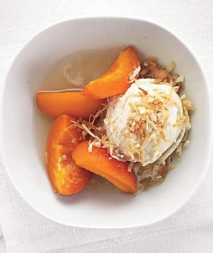 Ice Cream With Honey-Poached Apricots | Sprinkle toasted coconut shavings over a scoop of vanilla ice cream served with honey-poached apricots.