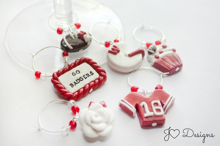 A personal favorite from my Etsy shop https://www.etsy.com/listing/385999018/college-football-wine-charms-football