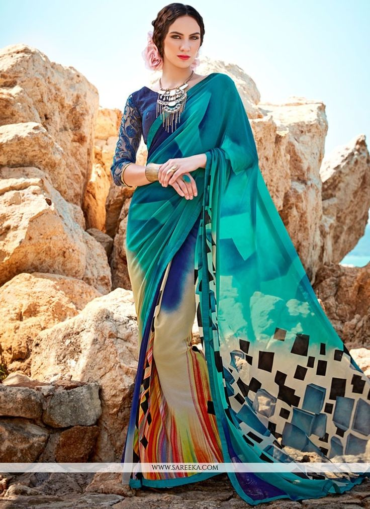 This delightful diva accoutre features unique styling and unusual material. Get the simplicity and grace with this multi colour faux georgette printed saree. The lovely digital print work throughout t...