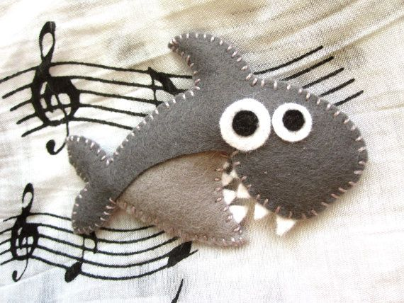 Hey, I found this really awesome Etsy listing at http://www.etsy.com/listing/153722078/piper-the-shark-cute-felt-brooch-animal