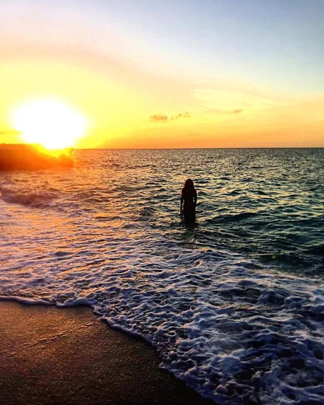 Soaking in all the vitamin sea I can as the sun dips down. Photo: nahgem__