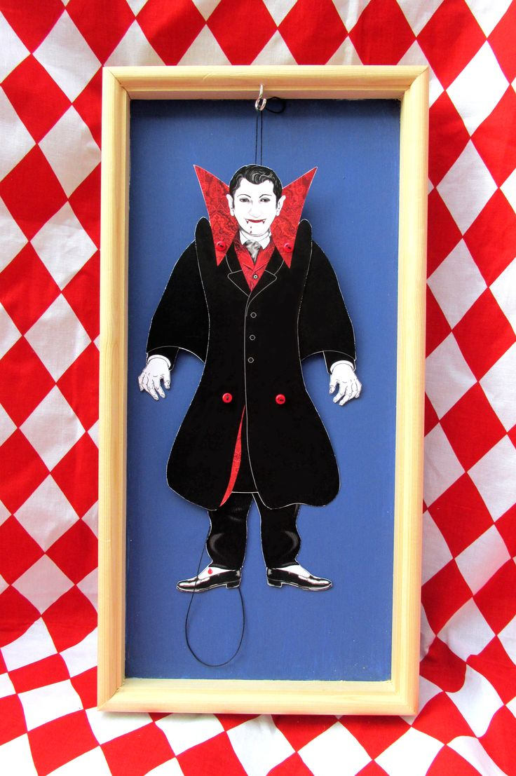 Completed vampire puppet. Use this £4.50 kit from www.sheilasmithpuppets.co.uk to make a traditional jumping jack puppet. New easy method - takes about 30 min to cut out and 10 min to assemble.  Dislay on a door or wall.