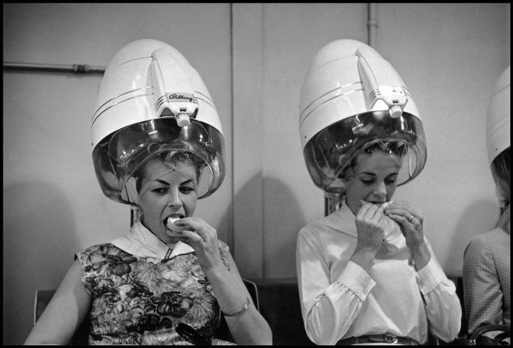 Constantine Manos USA. 1965. Women eat and have their hair done at a salon.