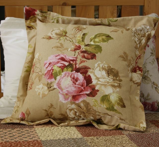 Floral printed cushion beige background