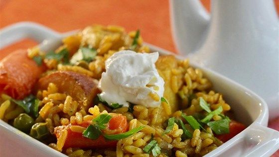 This bright yellow vegetarian biryani (tehri) is full of deliciously soft vegetables and fragrant long-grain rice cooked with Indian spices.