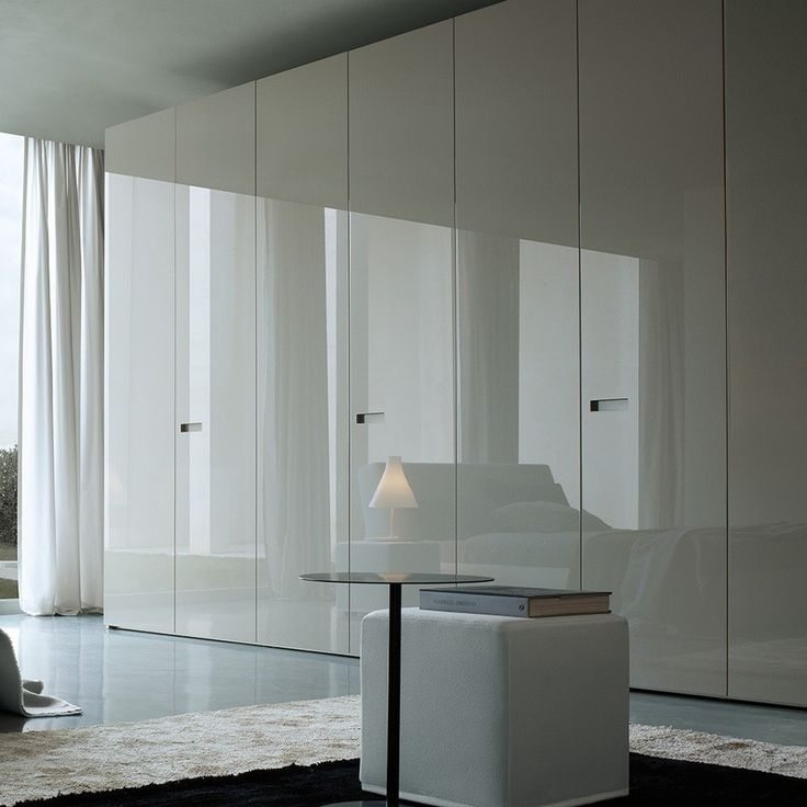 Wonderful Modern White Wardrobe Design Idea with White Curtain, White Floor Tile, and White Pouffe with Book