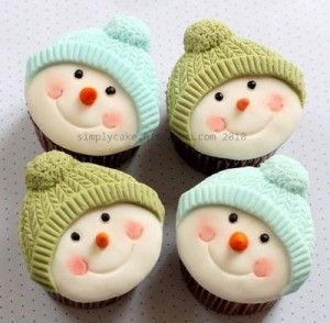 snowmen cupcakes - Toppers were made using Karen Davies cupcake moulds. http://www.karendaviescakes.co.uk/products/?Cup_Cake_Moulds  Here is a link to a tutorial from Karen about how to decorate these toppers - http://www.youtube.com/watch?v=Cyu2_qGsWJs