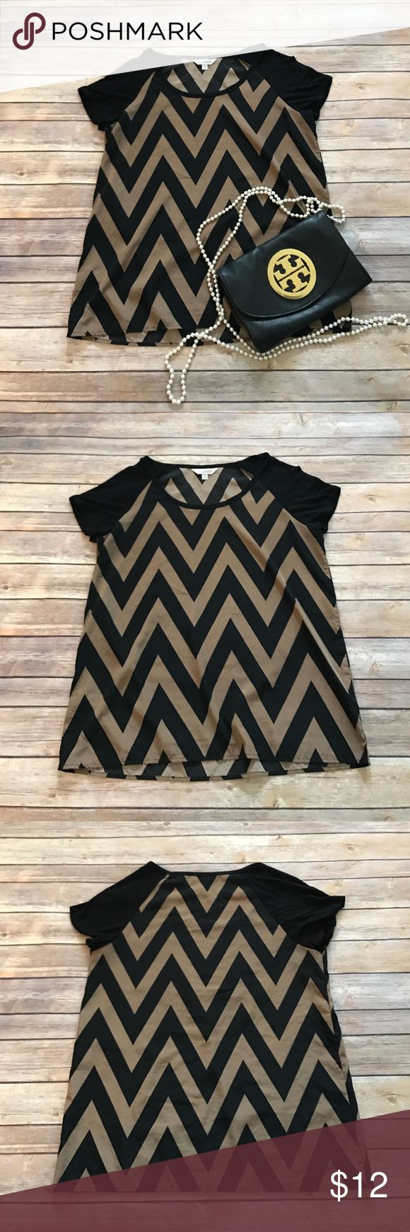"Charming Charlie chevron top Cute Charming Charlie chevron top in EUC. No holes or stains, measures 26"" in length. Make an offer or bundle and save! Charming Charlie Tops Tees - Short Sleeve"