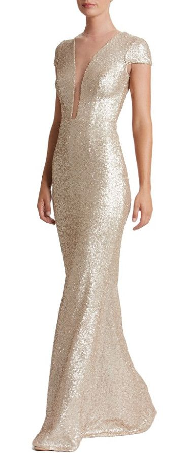 michelle sequin gown by Dress the Population. Dazzle through the evening in this slinky sequin gown that conceals and reveals with a plunging neck veiled by sheer mesh.  #dressthepopulation #dresses #gowns