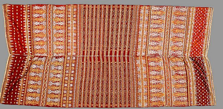 Shoulder or skirt cloth [kain bidak] 1800-99 Pasemah region Sumatra Indonesia cotton, silk, natural dyes, sequins, gold and silver thread weft ikat, supplementary weft weave, applique