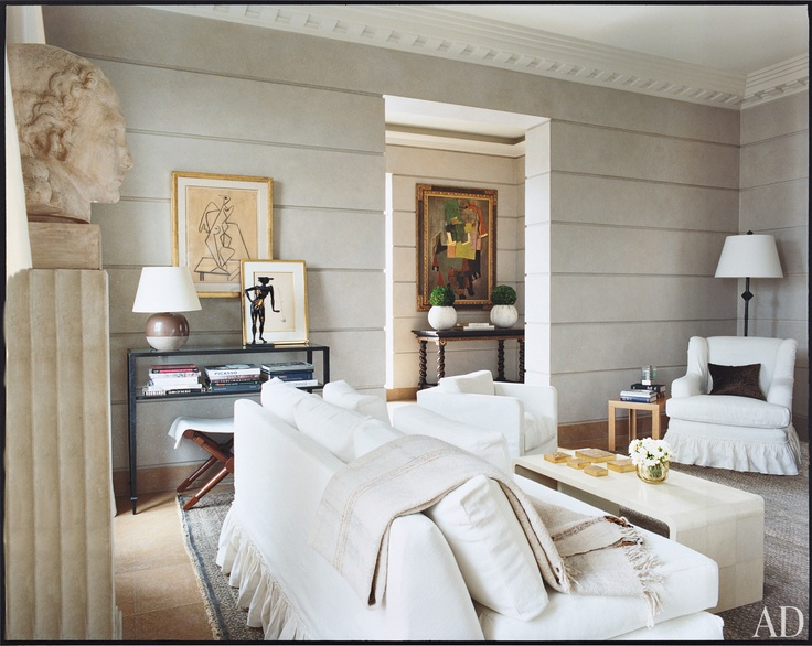 Love this living room. Planked walls, white upholstery.