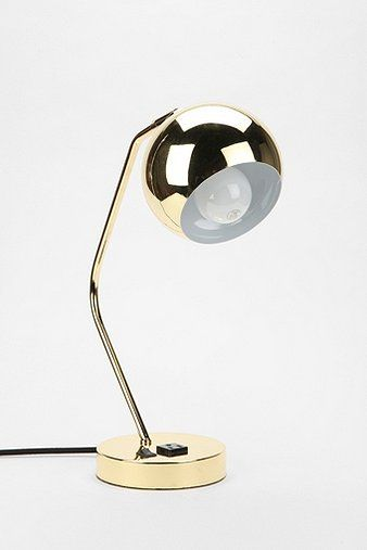 Mid-century modern-inspired desk lamp crafted from metal with a super high-shine finish