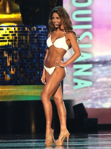 Miss Louisiana, Laryssa Bonacquisti    One of only 23 double preliminary winners in the organization's history, Laryssa brought her A-game to the competition this year! She chose a pose that showed off every muscle in her super toned frame.    The white swimsuit looks amazing with her olive skin and brunette hair. Big hair was a huge trend this year and Laryssa nailed it with this teased side-part.