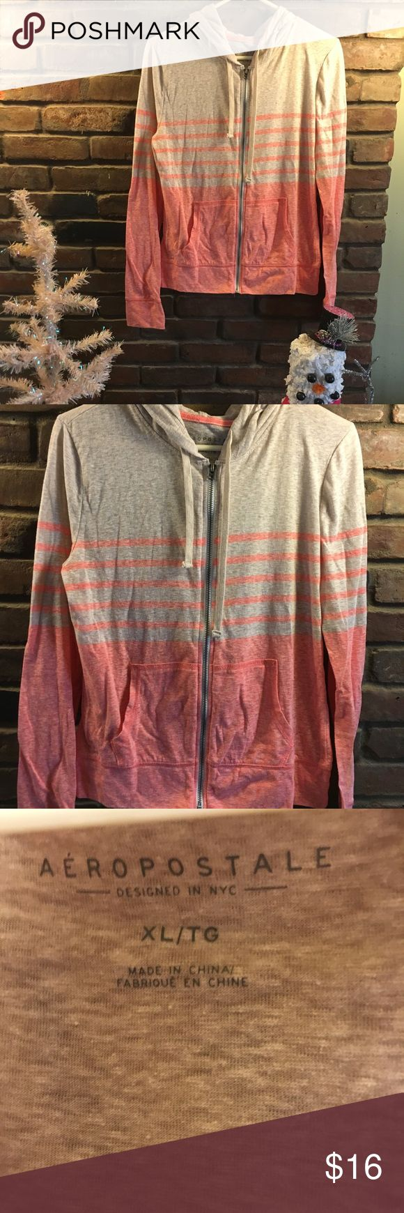 ‼️NEW LISTING‼️ 🍑Peach and nude hoodie🍑 Peach and nude lightweight hoodie. LIKE NEW, only worn twice. Does not fit true to size. Says XL but fits more like a medium. Very comfortable and perfect for spring☀️ another must have piece to add to your closet. HUGE discounts on bundles and 🆓 gifts with purchases🛍 please feel free to comment questions and offers are welcomed❤️ Aeropostale Tops Sweatshirts & Hoodies