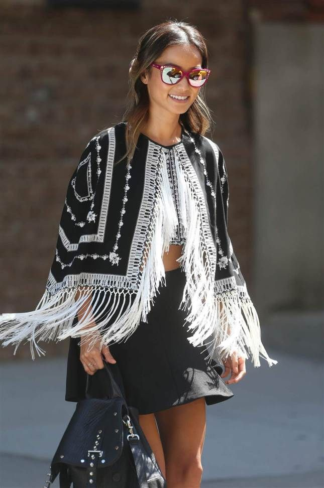 Olivia Palermo glänser i guldfärgade solglasögon