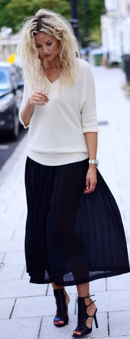 Loving how we'll put together this outfit is. Who'd thought sweater with a skirt and heels?!... Not me!...