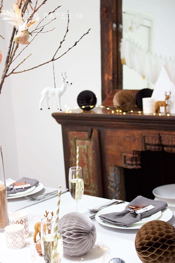 Bored with red, green & white? Why not mix it up with a new Christmas colour palette of copper, peach, grey, taupe, black and white. These colours look super chic on this Christmas Table Setting and Christmas Mantle Decorations.
