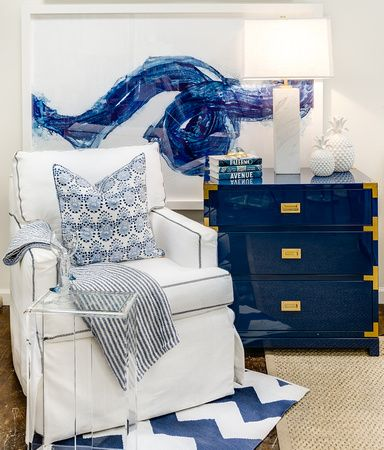 Coastal Interior Design Guide |  As with coastal-designed rooms, the bedroom lends itself to lots of whites and blues throughout. Blue campaign side table