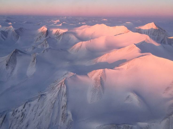 Ellesmere Island mountain tops bathed in light as the sun began to peak over the horizon.