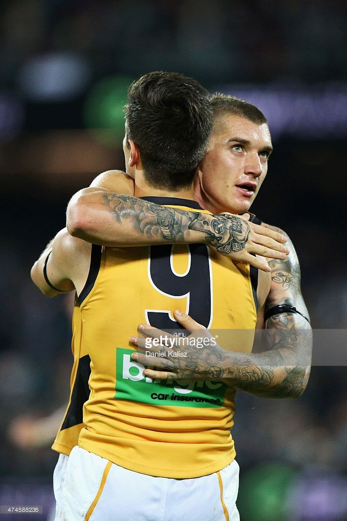 Trent Cotchin of the Tigers is congratulated by Dustin Martin of the Tigers after the round eight AFL match between the Port Adelaide Power and the Richmond Tigers at Adelaide Oval on May 24, 2015 in Adelaide, Australia.