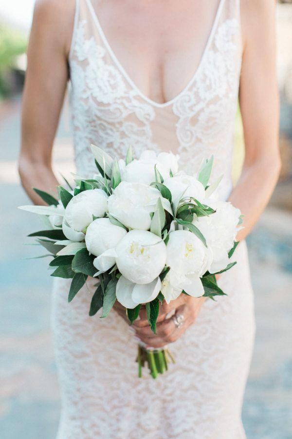 Gorgeous white peony wedding bouquet: http://www.stylemepretty.com/little-black-book-blog/2016/01/19/rustic-elegant-crete-destination-wedding/ | Photography: Anna Roussos - http://annaroussos.com/