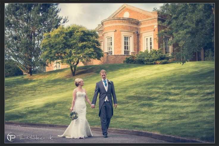 A newly married couple photographed in the grounds of #decourceys wedding venue, Cardiff