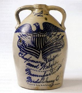 "It took a bid of $114,000 to win this cobalt blue salt glazed stoneware eagle and shield double-handled four-gallon jug, Ohio, dating from the second half of the Nineteenth Century. It is inscribed ""Chapman Weson and Wright Manufacturers, Middleburg, O."""