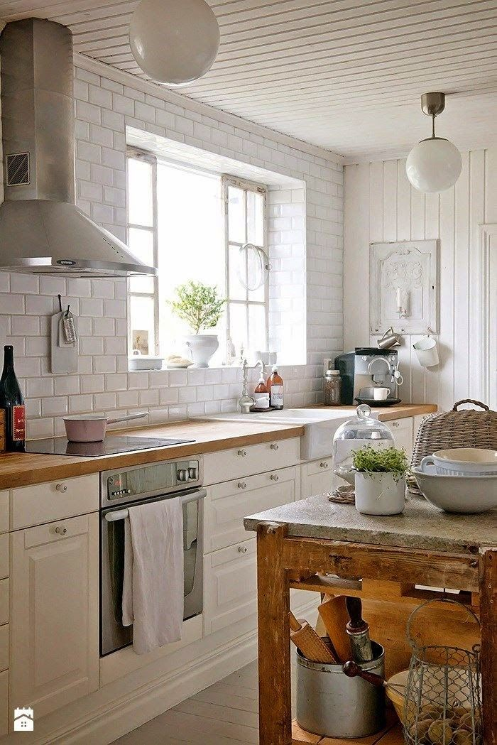 Beautiful! I love the mix of butcher block counters, white tiles, wood siding and farmhouse sink...