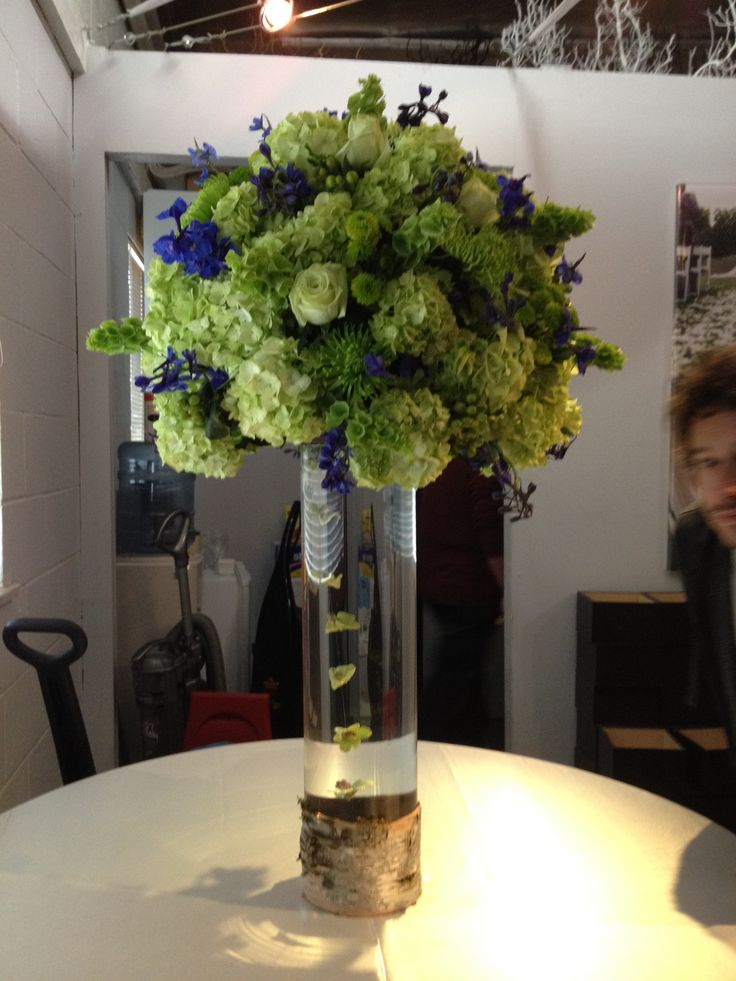 Tall blue and lime green reception wedding flowers
