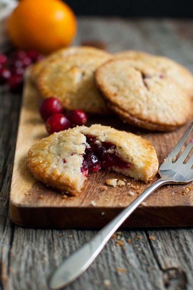 Cranberry Orange Hand Pies - a sweet-tart cranberry orange filling inside the most tender pie crust.   tamingofthespoon.com