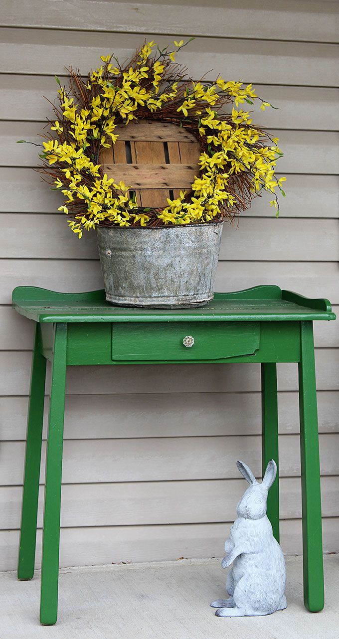 A simple and easy farmhouse spring porch decor idea made with things i drug out from