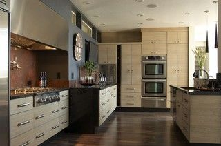 Different from what I usually gravitate towards, but like the warm earthy pallette, the flooring and cabinetry