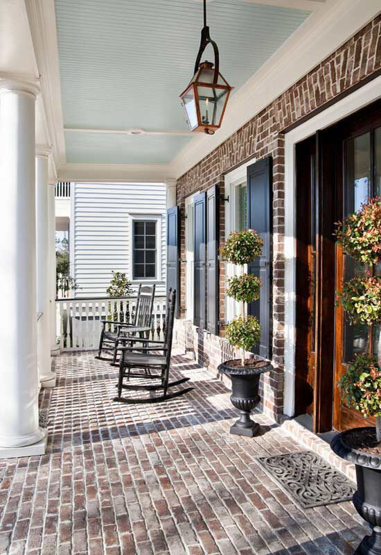 """Haint blue (""""Piazza Blue"""" by Sherwin Williams). Blue porch ceilings are a tradition in the south. Way back when, people believed this blue/green shade (called """"haint"""") kept evil spirits from entering their homes. These days, it's just a nod to the old tradition."""