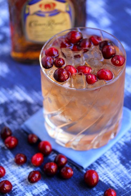Cranberry Whiskey Cocktail 1 oz. Crown Royal whiskey 1 oz. ginger ale 1 oz. cranberry juice Fresh Cranberries for garnish Instructions: In a cocktail shaker filled with ice, combine liquids and stir.  Then strain over ice into a rocks glass. Garnish with fresh cranberries
