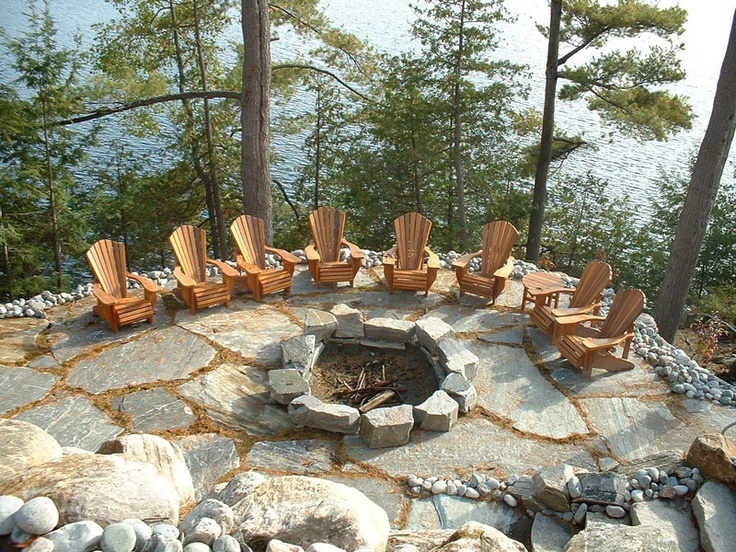 Fantastic fire pit and muskoka chairs overlooking the lake