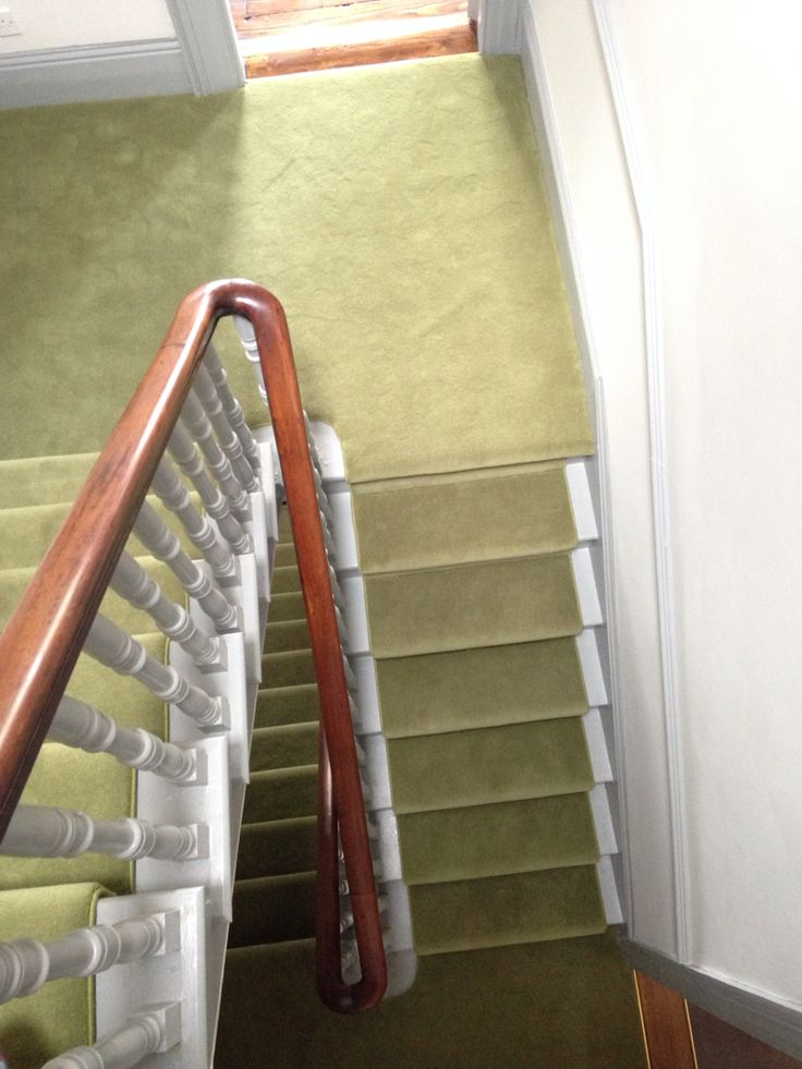 Victorian banister painted grey with green carpet