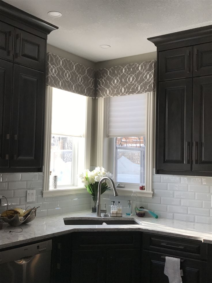 Hunter Douglas Silhouettes with a patterned fabric valance for that nook in your kitchen. Beautiful combination! Learn more about the many window covering options and more on our website: www.normandeauwc.com